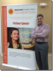 Suncoast Credit Union sponsors USF Young Innovator Competition - photo of poster and Anton Hopen